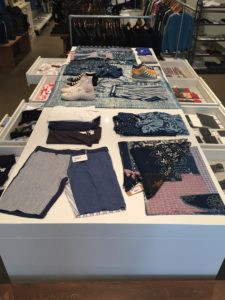 Pin Bu indigo hand made patch work scarves merchandised in PRESENT